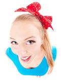 Cheerful funny girl isolated on white, fish eye lens shot — Stock Photo