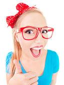 Funny girl s palcem nahoru — Stock fotografie