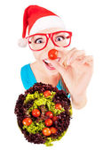 Funny santa girl playing with salad — Stock Photo
