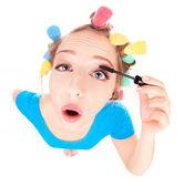 Funny portrait of girl applying mascara — Stock Photo