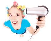 Funny girl styling hair, holding hairdryer — Stock Photo
