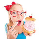 Funny girl with cupcake — Stockfoto