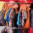 Nothing to wear concept, young woman deciding what to put on — Foto de Stock
