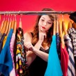 图库照片: Nothing to wear concept, young womdeciding what to put on