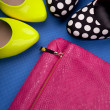 Stock Photo: Colorful high heels and snakeskin print bag