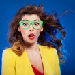 Colorful portrait of an attractive surprised girl — Stockfoto