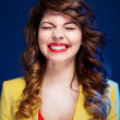 Portrait of an attractive young woman laughing hard — Stock Photo #18885975