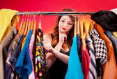 Nothing to wear concept, young woman deciding what to put on — Stockfoto