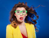 Colorful portrait of an attractive surprised girl — Stock Photo