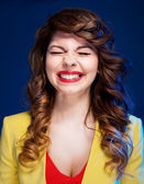 Portrait of an attractive young woman laughing hard — Stock Photo