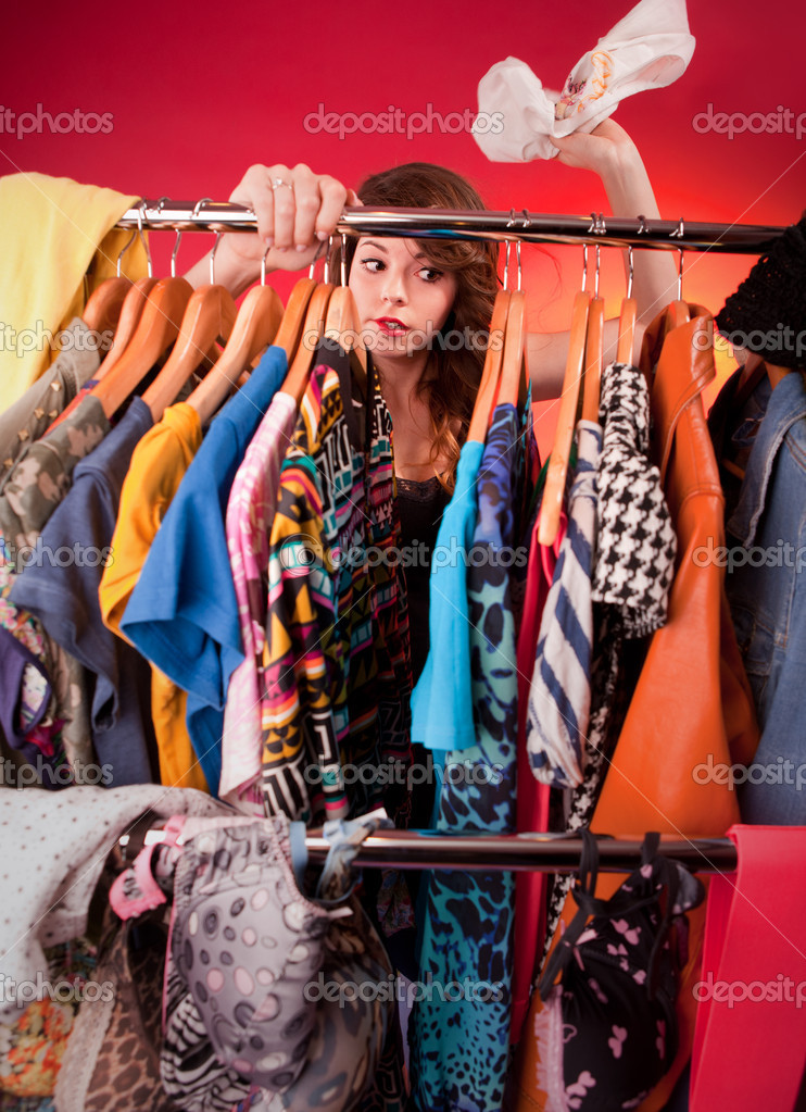 Nothing to wear concept, young woman deciding what to put on — Stock Photo #18885473
