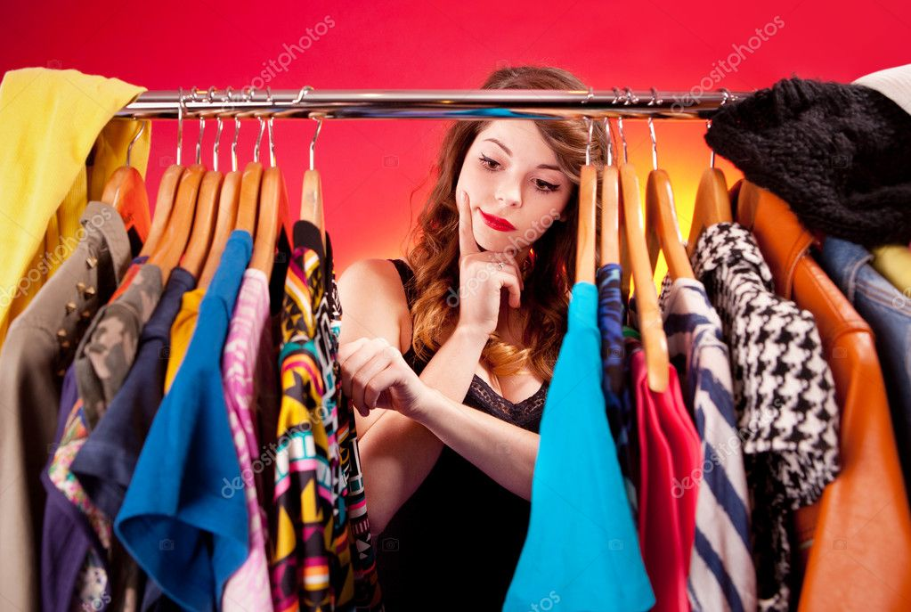 Nothing to wear concept, young woman deciding what to put on  Stock Photo #18885485