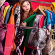 Nothing to wear concept, young woman deciding what to put on - Stockfoto