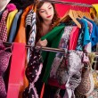 Stock Photo: Nothing to wear concept, young womdeciding what to put on