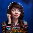 Girl with headphones enjoying music — ストック写真