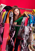 Nothing to wear concept, young woman deciding what to put on — Stock Photo