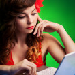 Colorful portrait of young woman working on a laptop — Stock Photo #21043001