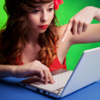 Colorful portrait of young woman working on a laptop — Stock Photo