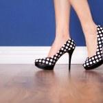 Woman wearing polka dot high heels — Stock Photo