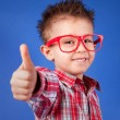 Royalty-Free Stock Photo: Cheerful five years old boy with thumb up