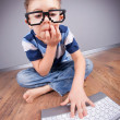 Stock Photo: Little boy with laptop computer