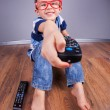 Cheerful child with tv remote control — Stock Photo #21043137