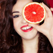 Portrait of pretty woman holding grapefruit — Stock Photo