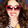 Attractive young woman in sunglasses - Stok fotoğraf