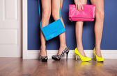 Two girls wearing high heels waiting at the door — Stock fotografie