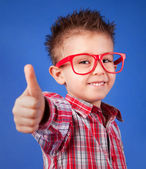 Cheerful five years old boy with thumb up — Stockfoto