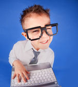 Five years old boy with a laptop computer — Stockfoto