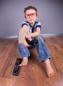Five years old boy watching tv — Stock Photo