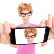 Funny nerdy guy is taking a self portrait with a smart phone — Stock Photo #23467256