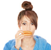 Woman with sausages simulating lip enhancement she's dreaming of filler injection — Stock Photo