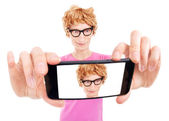 Funny nerdy guy is taking a self portrait with a smart phone — Stock Photo