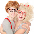 Happy nerdy couple embracing — 图库照片