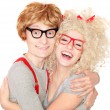 Foto Stock: Happy nerdy couple embracing