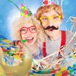 Funny nerdy couple celebrating - Stock Photo