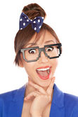 Photo of a funny surprised nerdy girl wearing 8 bit glasses — Stock Photo