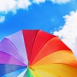 Rainbow umbrella on blue sky background — Stock Photo #25548785