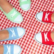 Girls wearing colorful sneakers — Stock Photo