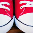 Red sneakers close up — Stock Photo #28729235