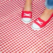 Girl wearing red sneakers — Stock Photo #28729241