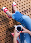 Woman relaxing on a patio — Stock Photo