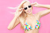 Beautiful young bikini girl wearing sunglasses — Stock Photo