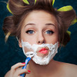 Stock Photo: Girl shaving face