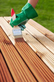 Applying protective varnish on a wooden furniture — Stock Photo