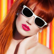 Stock Photo: Young womwith sunglasses