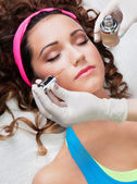 Woman getting face treatment — Stock Photo