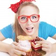 Funny woman eating dessert — Stock Photo #38609605
